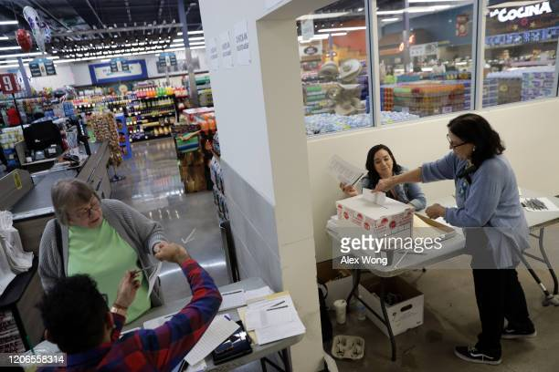 Voters participate in early voting in the Nevada Caucus at Cardenas Market February 15 2020 in Las Vegas Nevada The first time in the history...