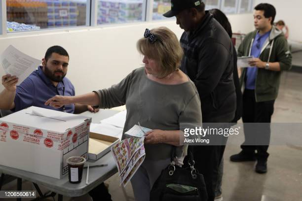 Voters participate in early voting in the Nevada Caucus at Cardenas Market February 15, 2020 in Las Vegas, Nevada. The first time in the history,...