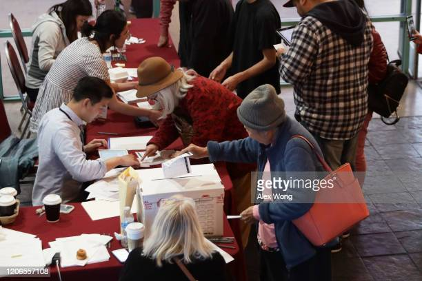 Voters participate in early voting in the Nevada Caucus at Chinatown Plaza Mall February 15 2020 in Las Vegas Nevada The first time in the history...