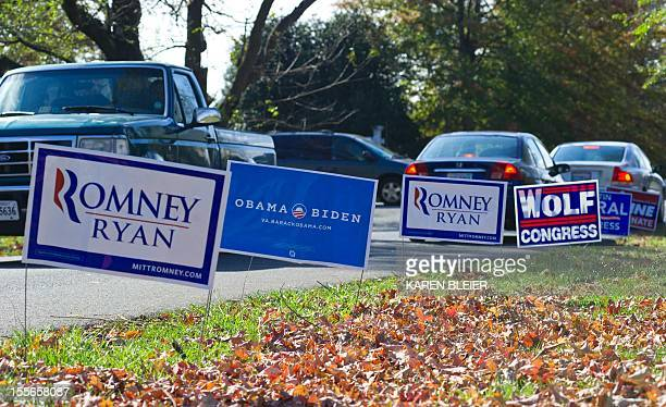 Voters pass many campaign signs as they come and go at the PACE School November 6 2012 in Haymarket Prince William County Virginia After a long and...