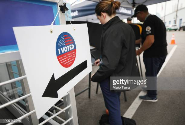 Voters prepare their ballots in voting booths during early voting for the California presidential primary election at a new L.A. County 'Mobile Vote...