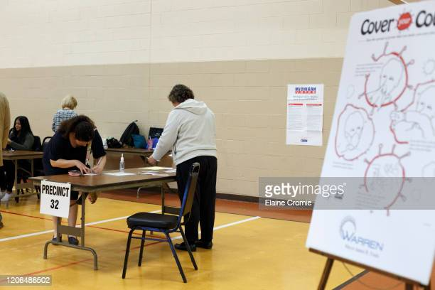 Voters prepare to cast their ballots at Warren Woods Baptist Church on March 10, 2020 in Warren, Michigan. Michigan is one of six states voting in...