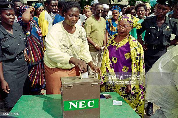 Voters put their ballot in the NEC box at the polling station on June 12 during Nigeria's first presidential election after 10 years of military rule