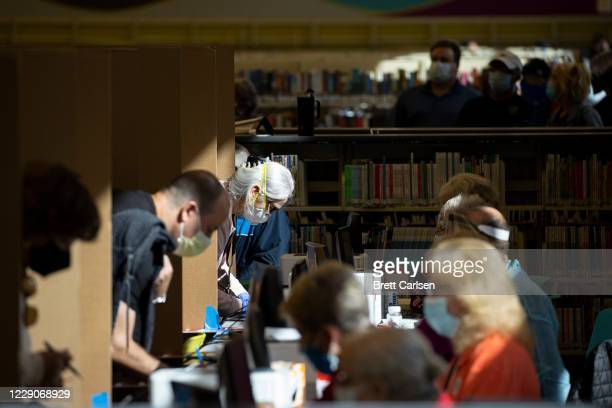 Voters queue inside of a library building to participate in early voting on October 14, 2020 in Nashville, Tennessee. Early voting in Tennessee...