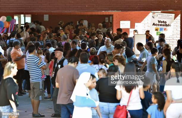 Voters queue outside a polling station during presidential elections in Asuncion on April 22 2018 Opinion polls give Mario Abdo Benitez of the ruling...
