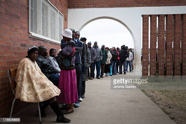 Voters queue outside a polling station in Harare's Mbare neighbourhood to cast their ballots in the country's presidential, parliamentary and local...