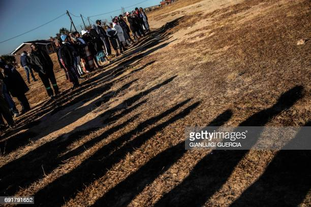 Voters queue to cast their ballot at a polling station on June 3, 2017 in Maseru, Lesotho, during Lesotho's general election. Voters in the small...