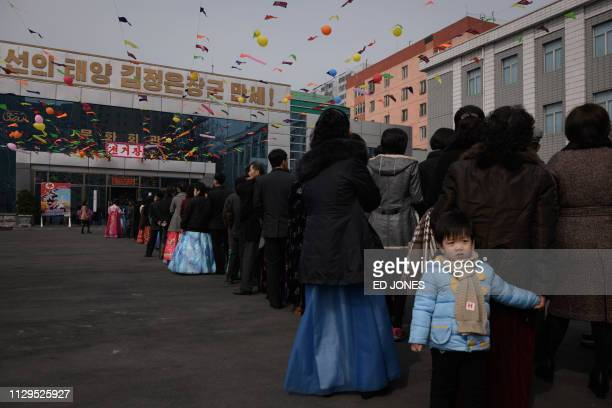 Voters queue to cast their ballots at a voting centre at the '326 Pyongyang Cable Factory' during voting for the Supreme People's Assembly elections...