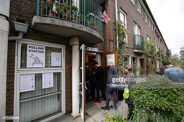 Voters queue to enter a polling station located in a community center as voting continues in the 2015 general election in the Southwark district of...