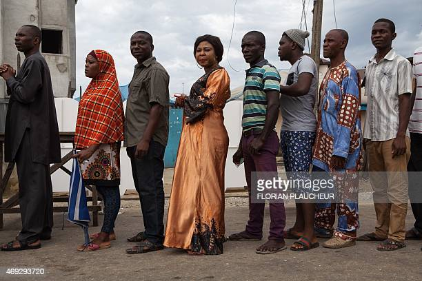 Voters queue to register to vote at a polling station in Port Harcourt on April 11 2015 Polling stations opened across Nigeria for gubernatorial and...