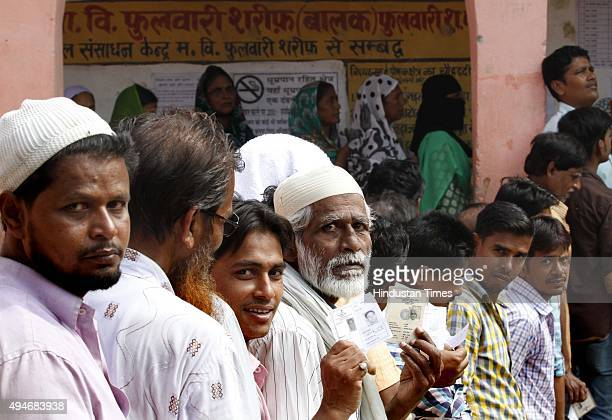 Voters queue up to cast their vote at DAV School polling booth for 3rd Phase of Bihar Assembly Election on October 28 2015 at Phulwari Sharif...