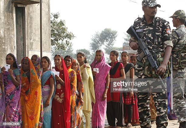 Voters queue up to cast their vote for 3rd Phase of Bihar Assembly Election on October 28 2015 at Maner constituency near Patna India Bihar will hold...