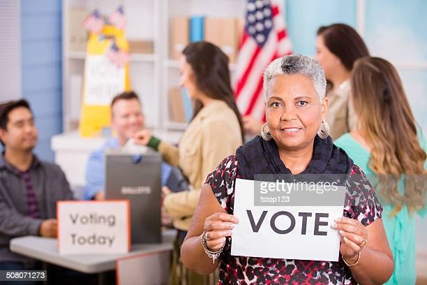voters register, voting in usa elections. woman holds 'vote' sign. - votes for women stock photos and pictures