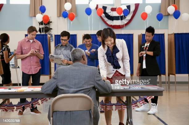 voters registering at polling place - election day stock photos and pictures