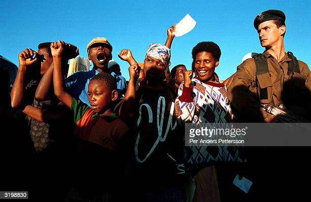 Voters sing while waiting to vote in a voting station on April 27 1994 in Lindelani in Natal Province South Africa The first democratic election was...