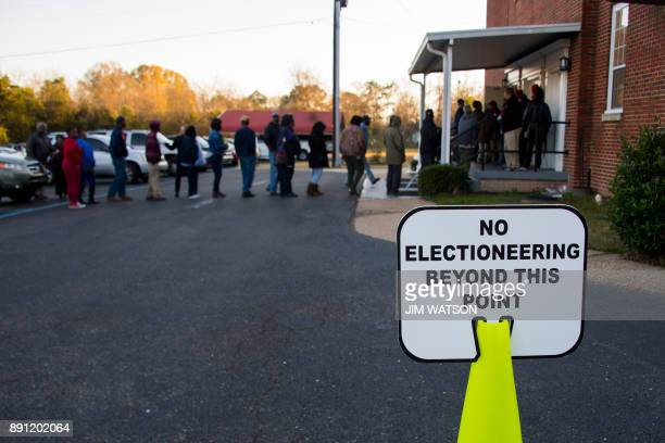 Voters stand in a long line that leads out the door to vote at Beulah Baptist Church polling station in Montgomery Alabama on December 12 2017 The...