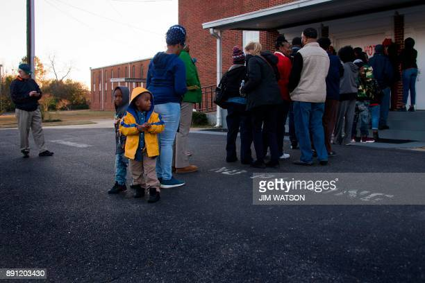 Voters stand in a long line that stretches out the door to vote at Beulah Baptist Church polling station in Montgomery Alabama on December 12 2017...