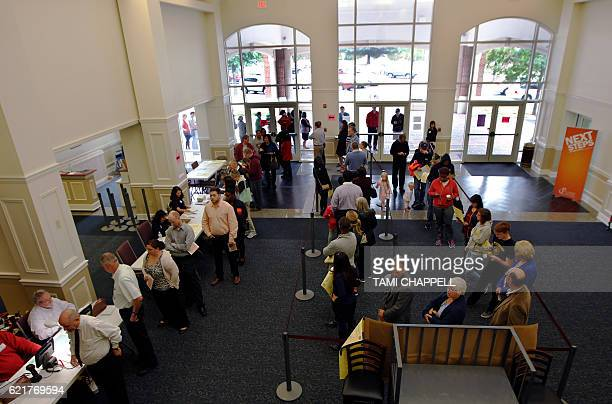Voters stand in line in the lobby at Peachtree Corners Baptist church as they wait to vote in the US presidential election in Peachtree Corners...