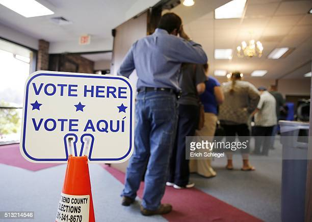 Voters stand in line to cast their ballots inside Calvary Baptist Church March 1 2016 in Rosenberg Texas Voters in 12 states go to the polls in...