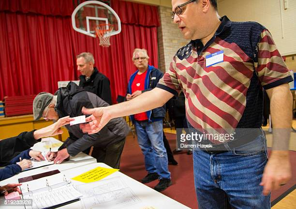 Voters take to the polls on April 5 2016 in Wauwatosa Wisconsin Republicans and Democrats both cast their votes in today's presidential primaries