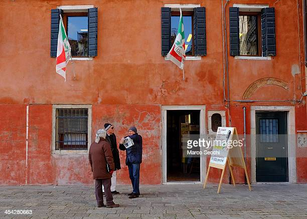 Voters talk in front of a Democratic Party polling station during today primary elections on December 8 2013 in Venice Italy Italians are voting...