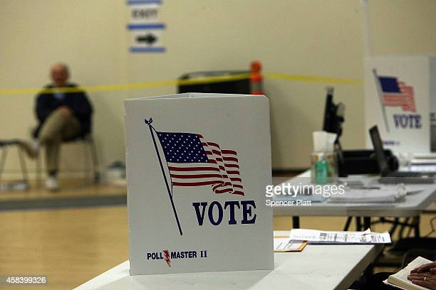 Voters turn out to cast their ballots at a polling station on November 4 2014 in Westport Connecticut Around the country voters are turning out to...