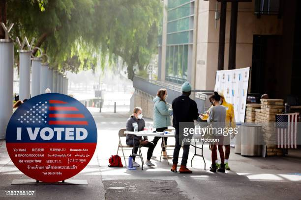 Voters visit The Hollywood Bowl on November 03, 2020 in Los Angeles, California. Several iconic Los Angeles landmarks that were temporarily closed...
