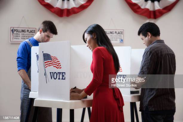 voters voting in polling place - voting stock pictures, royalty-free photos & images
