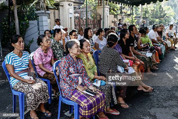 Voters wait at a polling station during legislative elections on April 9 2014 in DenpasarBali Indonesia Indonesia held legislative elections today...