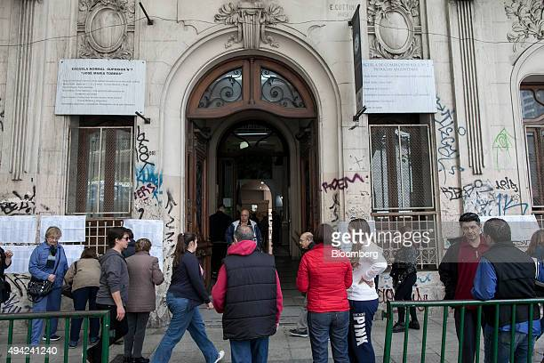 Voters wait at a polling station to cast their vote for president in Buenos Aires Argentina on Sunday Oct 25 2015 Argentina is moving a step closer...