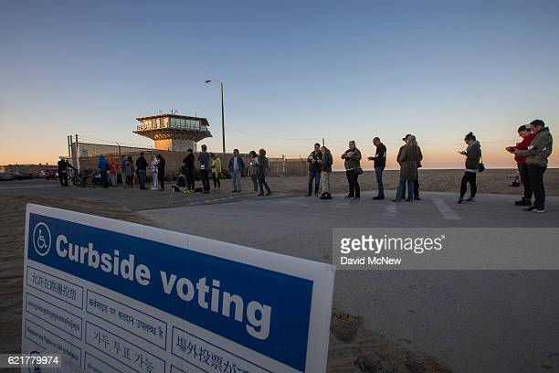 Voters wait for polls to open at the Los Angeles Lifeguard station at Venice Beach on November 8 2016 in Los Angeles United States In addition to...