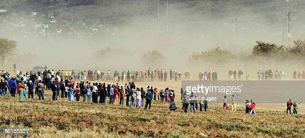 Voters wait in a long queue to cast their vote in the general election at a settlement on April 22 2009 in Tshwane South Africa The ruling African...