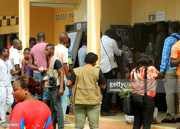 Voters wait in a queue at a polling station during the Togolese presidential election in Lome, capital of Togo on April 25, 2015. Togolese Voters...