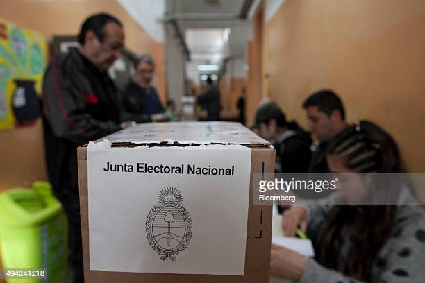 Voters wait in line at a polling station to cast their vote for president in Buenos Aires Argentina on Sunday Oct 25 2015 Argentina is moving a step...