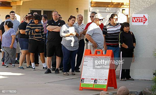Voters wait in line at the Maryvale Church of the Nazarene polling place to cast their vote on November 8 2016 in Phoenix Arizona Americans across...