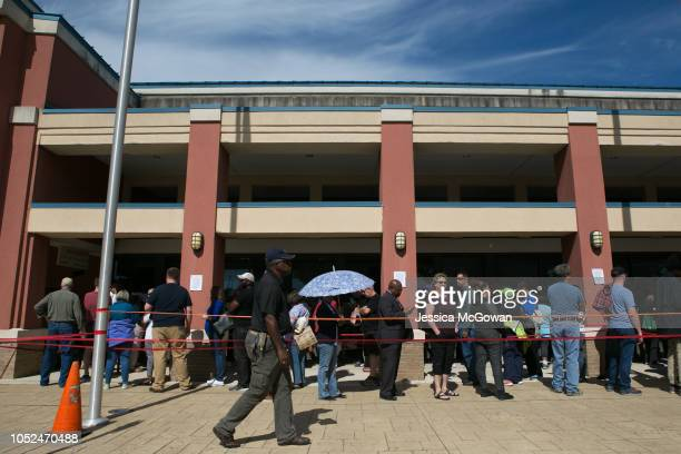 Voters wait in line for up to two hours to early vote at the Cobb County West Park Government Center on October 18 2018 in Marietta Georgia Early...