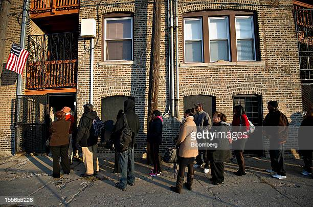 Voters wait in line outside a polling station in Chicago Illinois US on Tuesday Nov 6 2012 US President Obama is seeking to overcome the drag of high...