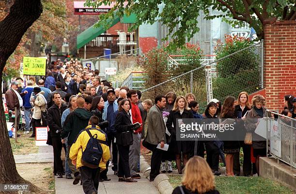 Voters wait in line outside the Foundry United Methodist Church in Washington DC to cast their vote in the US presidential election 07 November 2000...