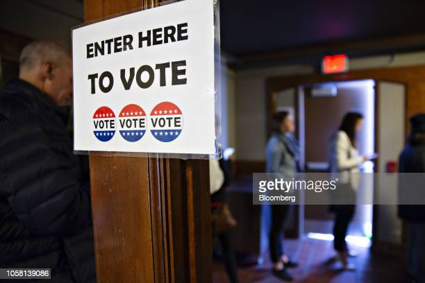 Voters wait in line to cast ballots at a polling station inside Hoyt Park Grand Hall in Wauwatosa, Wisconsin, U.S., on Tuesday, Nov. 6, 2018. More...