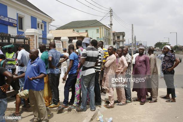 Voters wait in line to cast their ballots at a polling station in Lagos Nigeria on Saturday Feb 23 2019 Nigerians began voting in Africas biggest...