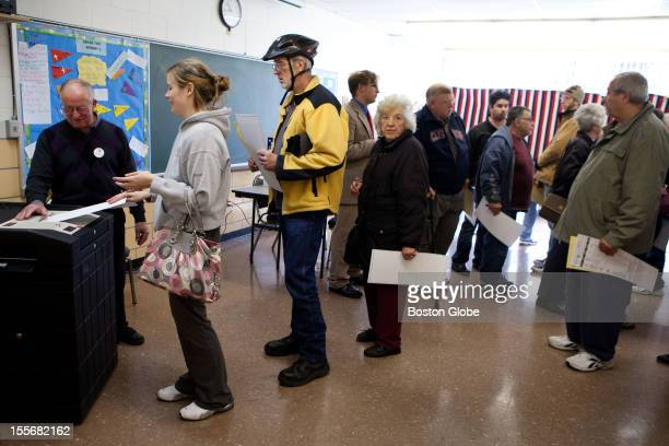 Voters wait in line to cast their ballots at St Pius CCD Center in Manchester New Hampshire on Election Day November 6 2012