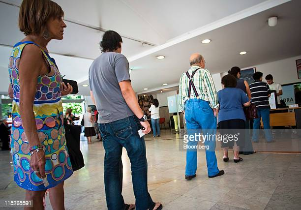 Voters wait in line to cast their ballots during the Portuguese elections in Lisbon Portugal on Sunday June 5 2011 Portugal's opposition Social...