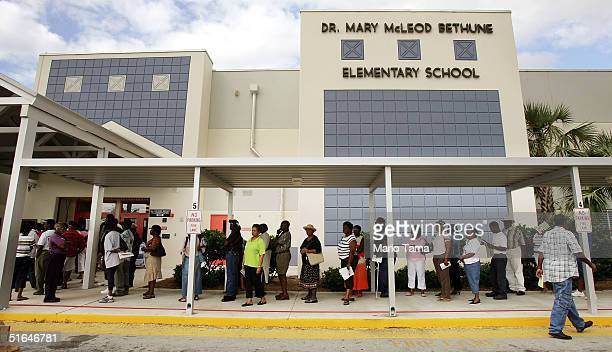 Voters wait in line to cast their ballots in Palm Beach County November 2 2004 in Riviera Beach Florida Polls showed President George W Bush and...