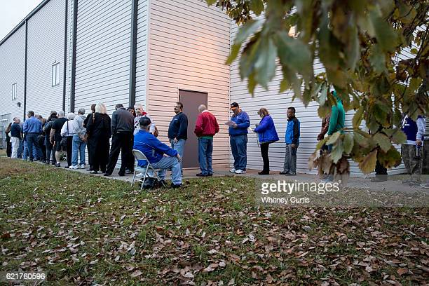 Voters wait in line to cast their ballots on November 8 2016 Kansas City Missouri Americans will choose between Republican presidential candidate...