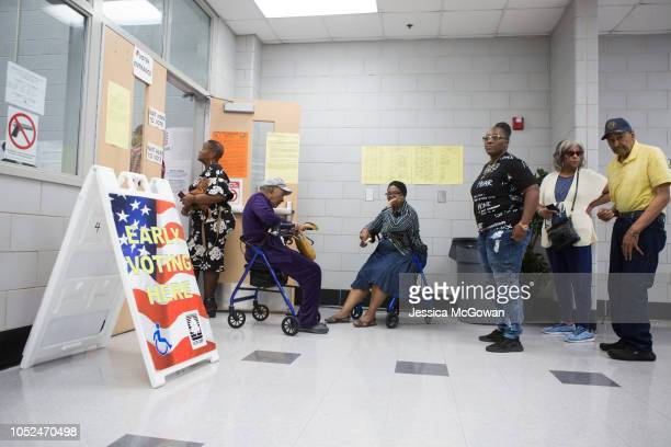 Voters wait in line to early vote at CT Martin Natatorium and Recreation Center on October 18 2018 in Atlanta Georgia Early voting started in Georgia...