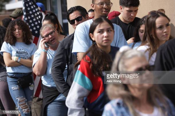 Voters wait in line to enter an early voting location at IBEW Local 357 to cast their votes in the Nevada Caucus February 15 2020 in Las Vegas Nevada...