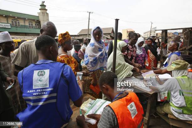 Voters wait in line to register to cast their ballots at a polling station in Lagos Nigeria on Saturday Feb 23 2019 Nigerians began voting in Africas...