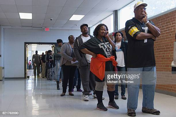 Voters wait in line to vote in the 2016 Presidential Election at Hazelwood Central High School on November 8 2016 in Florissant Missouri Americans...