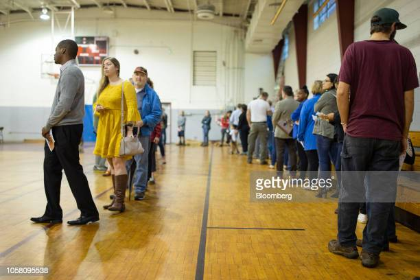 Voters wait in line to vote in the Midterm Elections at First Iconium Baptist Church in Atlanta, Georgia, U.S., on Tuesday, Nov. 6 2018. Today's...