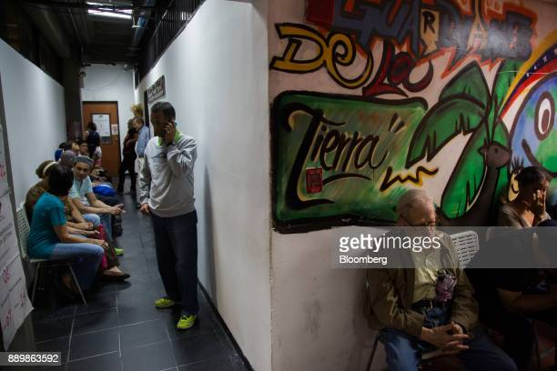 Voters wait inside a polling station during a nationwide mayoral election in Caracas Venezuela on Sunday Dec 10 2017 Major opposition parties...